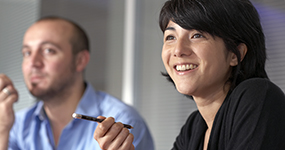 Man and woman in a meeting, woman is smiling